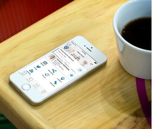 Coffee on Table with Whova mobile app