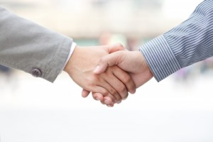 shaking hands at a networking event